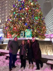 Kay Davis (center left), enjoys Christmas Eve in downtown