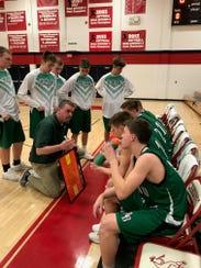 Almond-Bancroft basketball coach Curt Lamb offers some
