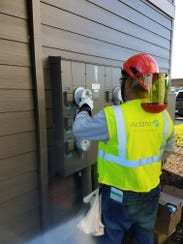Aclara contractors install meters for Pacific Power