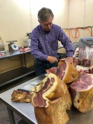 Allan Benton's process uses salt, sugar and time — months, even. His hams can take years to cure.