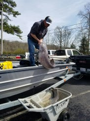 Although he usually fishes just for fun, Matt Girman, of Roane County, caught this 51-pound catfish for a catfish club tournament on March 17.