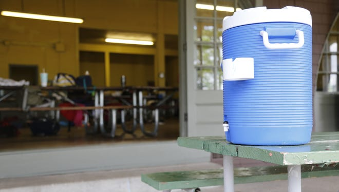 An empty water cooler sits on a table at the Stewart Park pavilion during Ithaca Youth Bureau day camp Thursday afternoon.