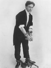 Magician Harry Houdini is shown in one of his classic escape routines.