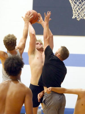 Boonville senior Lane West shoots over a Warrensburg player during a scrimmage last Thursday at Hannah Cole Elementary. The scrimmage against Warrensburg was the first of the season for the Boonville boys basketball team, which has been regulated to skill work and open gyms in June due to the coronavirus.