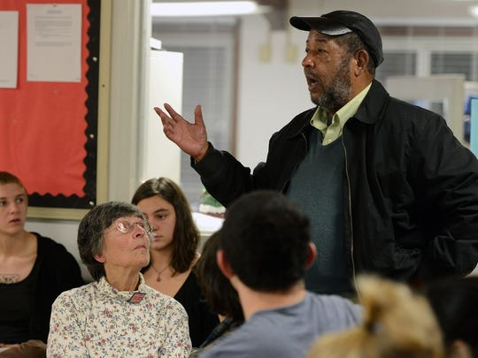 Isaac Coleman, a former public housing manager at Pisgah View and Deaverview, speaks at the HoodTalk forum on Dec. 18.