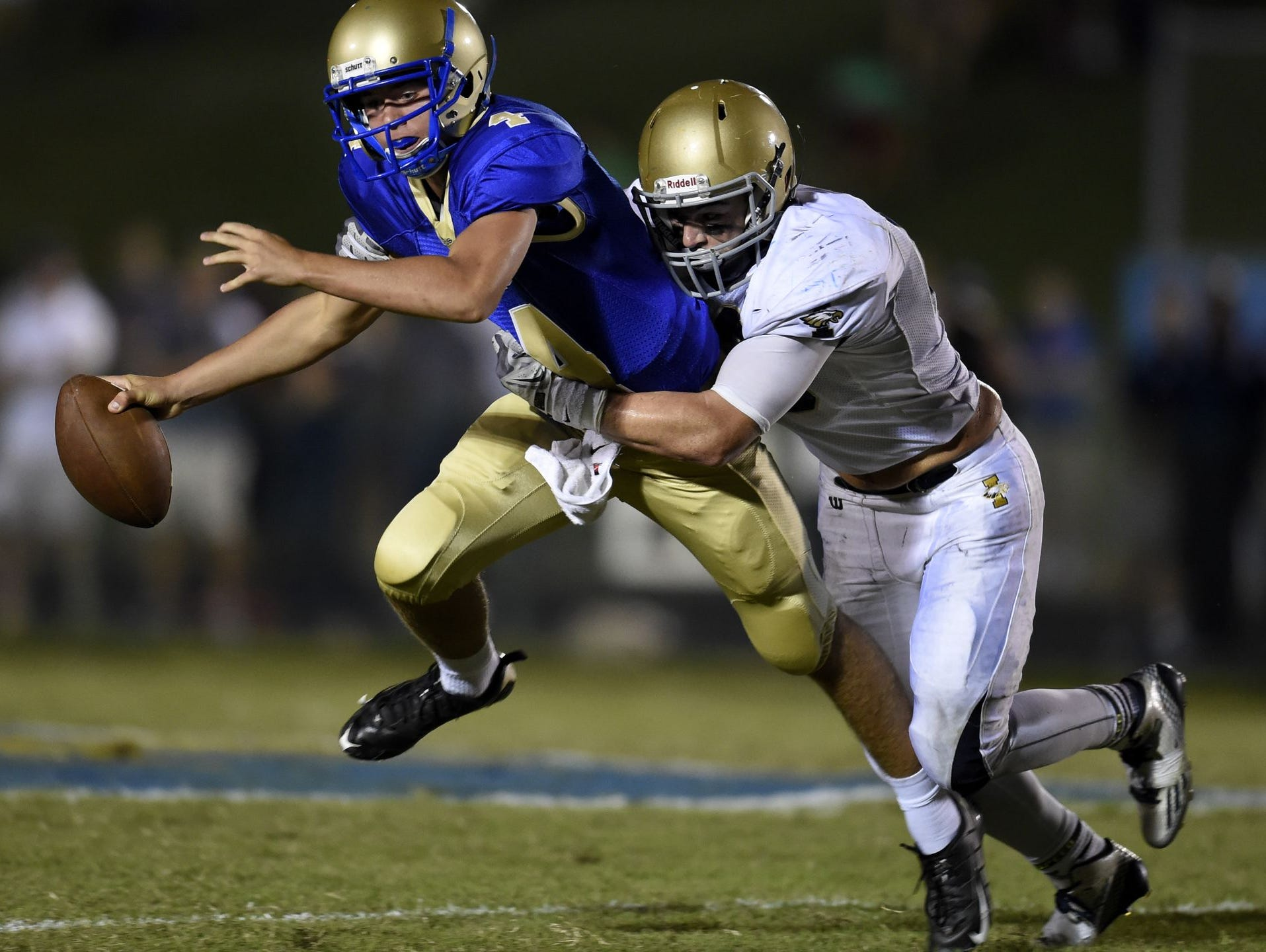 Independence's Hunter Dupree (right) wraps up Brentwood quarterback Carson Croy.