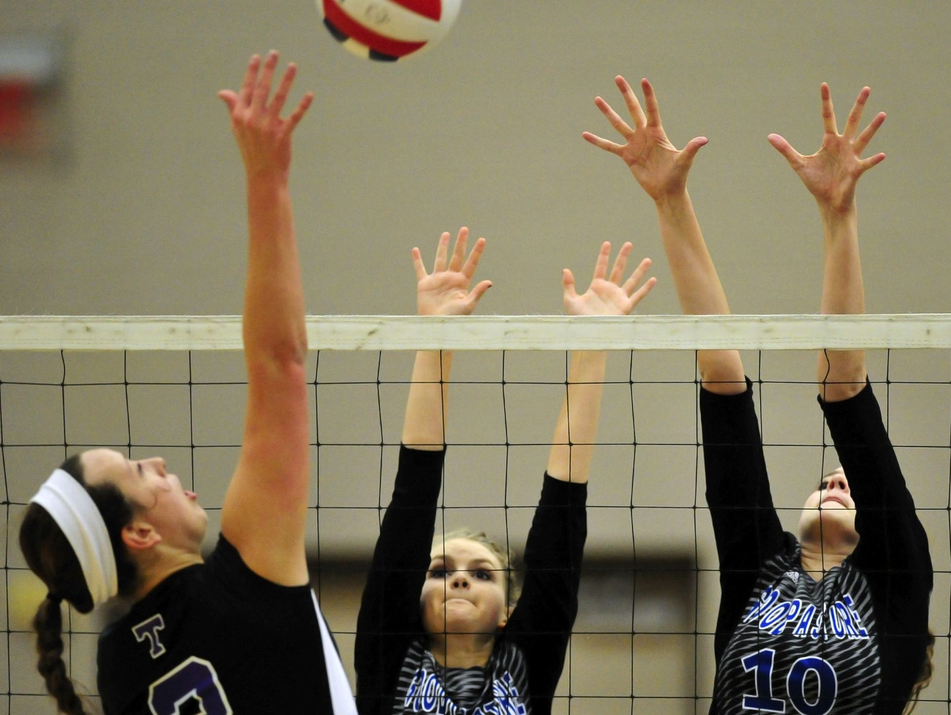 Goodpasture's Lou Phillips (11) and Jordan Jones (10) attempt to block a shot during last year's Class A championship match.
