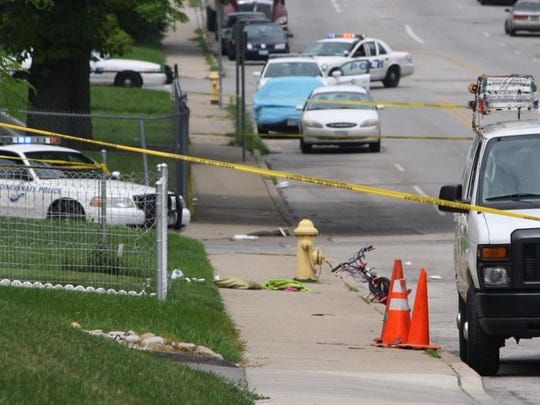 Crime tape stretches across the scene where China Kinebrew was shot in Avondale on July 6, 2015.
