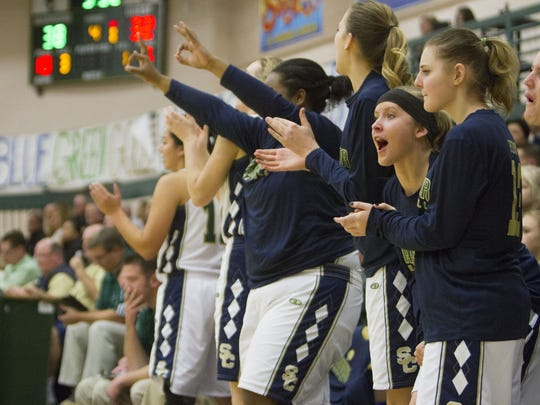 Snow Canyon players cheer during the second half of its game against Pine View. The Warriors beat the Panthers 53-41 Tuesday, Feb. 2, 2016.