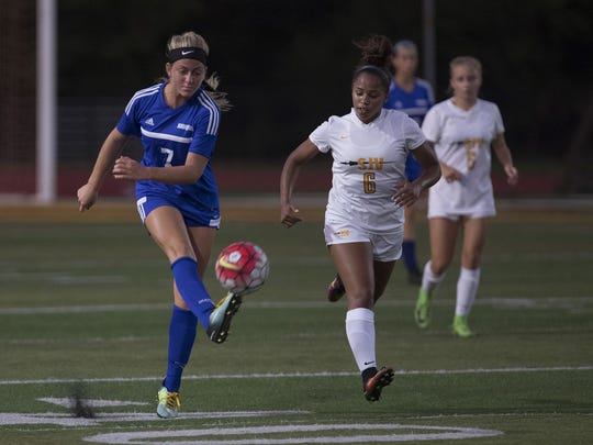 St. John Vianney senior midfielder Camaren Cox (No. 6) chases down Shore Regional's Frankie McDonough (No. 7) in a Class A Central game on Sep. 20, 2017