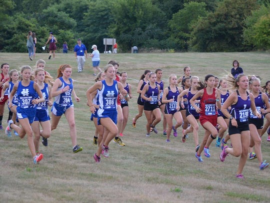 Runners take off for the start of the 2017 All-City Cross Country Meet.