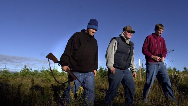 Shane Christensen, Jared Hartford and Jason Hartford finish up a morning of deer hunting.