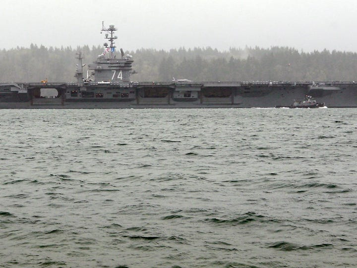 The USS John C. Stennis sails through the heavy rain