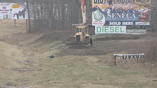 A bulldozer works on sme type of project between the Thruway and a Seneca smoke shop on the Cattaraugus Reservation south of Buffalo.