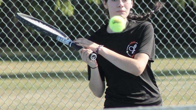 Nancy Guerrero of Kewanee returns a serve in singles play on Thursday at Northeast Park in Kewanee.