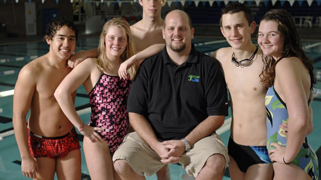 Greater Pensacola Aquatic Club head coach Phil Kraus (center), shown in this file photo, was named Southeastern Swimming Senior Coach of Year.