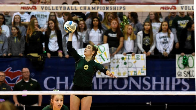Mikayla Haut of St. Mary Catholic Central hits the ball during last year's state semifinals at Kellogg Arena in Battle Creek. Haut, who recently committed to Fairfield University, is a finalist for the Michigan Miss Volleyball award.