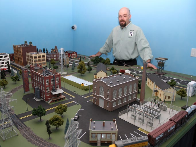 Ed Skoudis of the Sans Institute talks about his miniature town called CyberCity. The town is used to train people on how to battle cyber terrorism.  Monday August 4, 2014 Wall NJ.    Photo by Robert Ward
