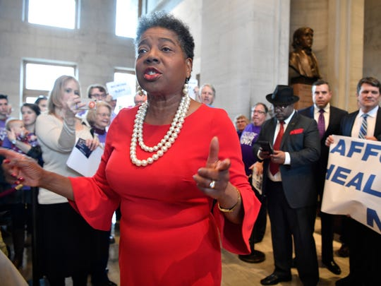 Brenda Gilmore, D-Nashville, joins with protestors calling for legislation dealing with health care in Tennessee before the first day of the 2018 Tennessee General AssemblyTuesday Jan. 9, 2018, in Nashville, Tenn