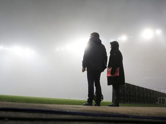 Mist covers the Lyon stadium prior to the Group H Champions League soccer match between Lyon and Sevilla in Decines, near Lyon, France, Wednesday, Dec. 7, 2016. (AP Photo/Laurent Cipriani)