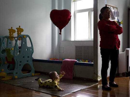 APTOPIX Emptying The Orphanages