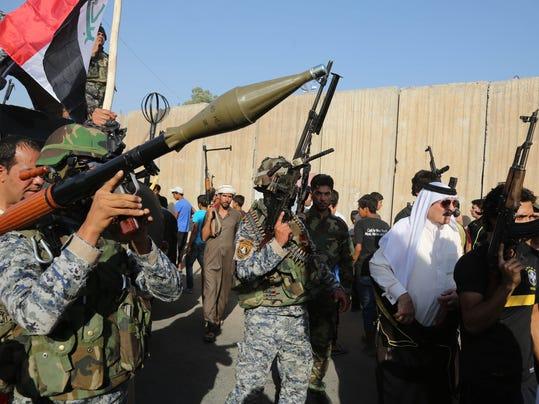 2014 395766524-Mideast_Iraq_XKK106_WEB118807.jpg_20140616.jpg