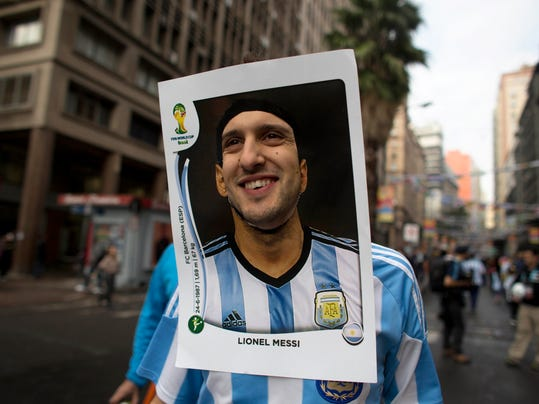 An Argentina soccer fan wears a cutout image of Argentine soccer star Lionel Messi as he heads to the stadium to see the World Cup match between Argentina and Nigeria in Porto Alegre, Brazil, Wednesday, June 25, 2014.  (AP Photo/Dario Lopez-Mills)