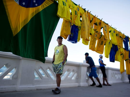 Brazil soccer jerseys hang for sale in Salvador, Brazil, Monday, June 30, 2014. Salvador is one of many cities hosting World Cup soccer games. (AP Photo/Rodrigo Abd)