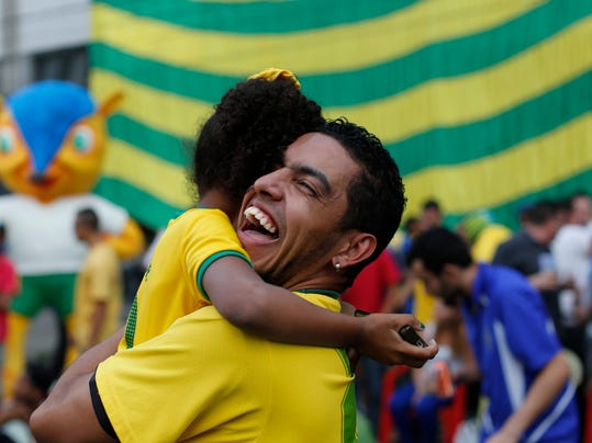Brazil soccer fans celebrate after Brazil scored against Colombia at a World Cup quarterfinal match as they watch the game at the Vai Vai Samba school in Sao Paulo, Brazil, Friday, July 4, 2014. (AP Photo/Dario Lopez-Mills)