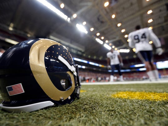 St. Louis Rams defensive end Robert Quinn, right, and Eugene Sims take part in a drill during NFL football training camp at Edward Jones Dome Saturday, Aug. 2, 2014, in St. Louis. (AP Photo/Jeff Roberson)