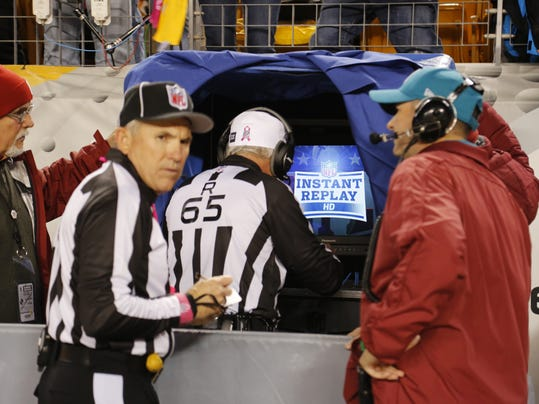 FILE - In this Oct. 20, 2014, file photo, NFL referee Walt Coleman, center, enters the Instant Replay sideline booth to review a play during the NFL football game between the Pittsburgh Steelers and the Houston Texans in Pittsburgh. NFL owners shot down nearly every video replay proposal brought to their meetings Tuesday, March 24, 2015, while approving several safety rules enhancements.  (AP Photo/Gene Puskar, File)