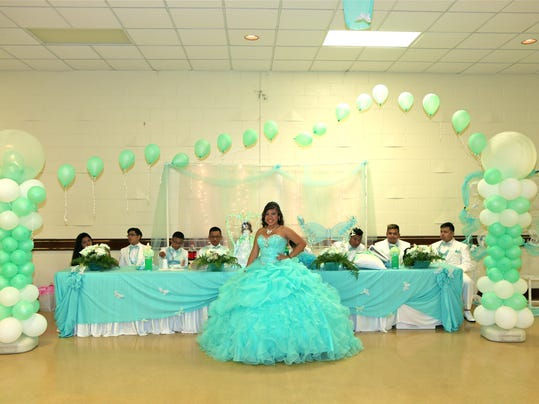 Inside a quinceanera Family friends pitch in to help