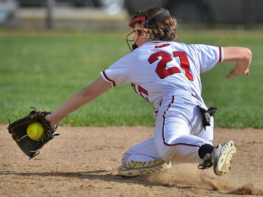 Rocori High School shortstop Rachel Neugart (21) makes a diving catch for an out in the fifth inning of their first game against Fergus Falls Tuesday evening, May 17 at Rocori. Rocori went on to win the first game 6-1.