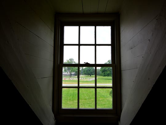 The family cemetery is visible from a second floor window of the Strickler House, built in 1740 and now part of the York County Prison  property. Friday, June 24, 2016. John A. Pavoncello photo