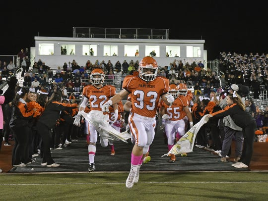 Central York players take the field before a District