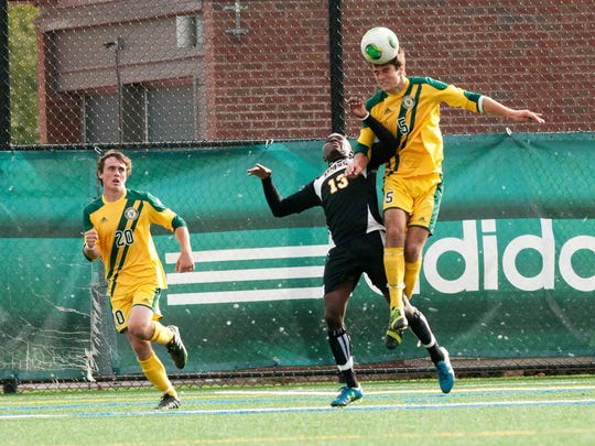 Vermont's Charlie DeFeo (5) leaps over UMBC's Kadeem Dacres (13) to head the ball during a game at Virtue Field on Oct. 16, 2013. DeFeo was a first-team all-conference midfielder as a sophomore that year, before knee and ankle injuries hampered his past two seasons.