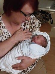 Kayla Britton's mother, Brenda Pitrowski, holds her
