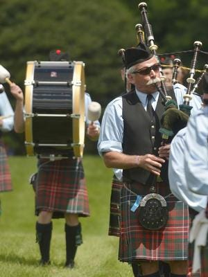 Ed Nettle of Plymouth plays with the Cabar Feidh band in the massed bands march at a previous Highland Games. The games return to Greenmead July 31 and Aug. 1.