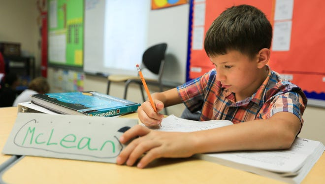 Fifth grader McLean Knight checks over his math assignment, August 22, 2016, in class at Hillrise Elementary School. Knight won a recipe-creation competition focusing on healthy food in which he was able to meet First Lady Michelle Obama.