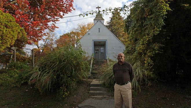 Marion Blount, with Antioch Baptist Church, stands in front of the former church that is slated to be used to create affordable units on Railroad Avenue in Bedford Hills.