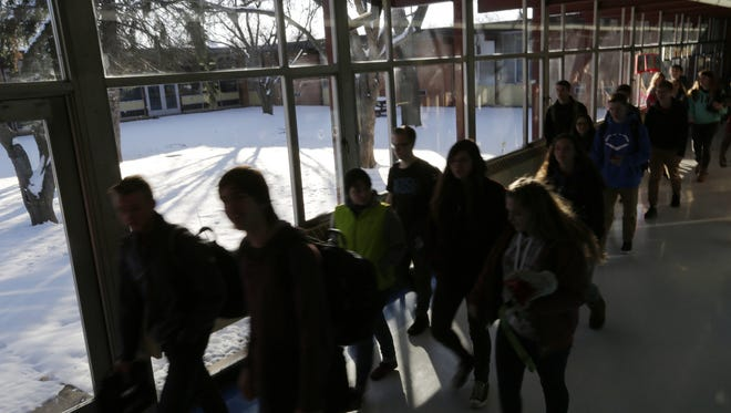 As Oshkosh West students pass between classes, they walk by floor-to-ceiling windows that are not energy efficient and can break if they are hit or run into during the course of the day.