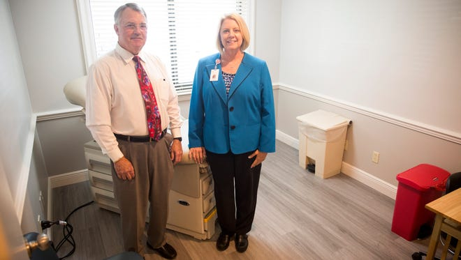 Karen Smith, the director of administrative operations, and Mike Ellis, the CEO of the Healthcare Network of Southwest Florida, at the new family care facility at the David Lawrence Center on Tuesday, May 2, 2017.