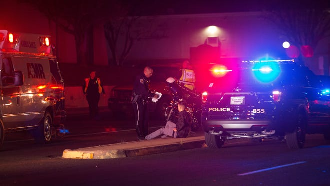 Las Cruces Police investigate the scene of a pedestrian collision involving a Ford F150 and two children ages 5 and 11, near 900 S. Teslshor Blvd. Thursday Dec. 21, 2017.