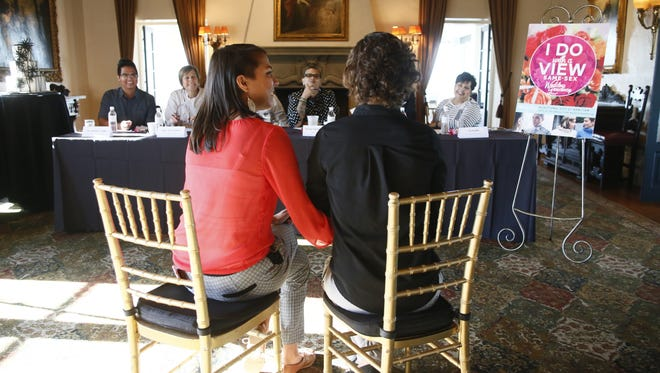 Lily Spurlock (left), 25, and Rebecca Periut (right), 25, tell their love story to a six-person panel of judges at the Wrigley Mansion on Oct. 27, 2014, in hopes of winning a 100-person wedding valued at $60,000.