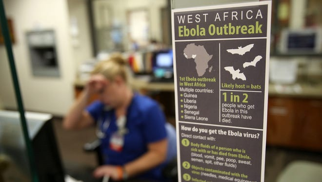 A sign in the admittance area of the emergency department at Salem Hospital describes the Ebola Outbreak and the signs of the virus. The photo was taken on Friday, Oct. 3, 2014.