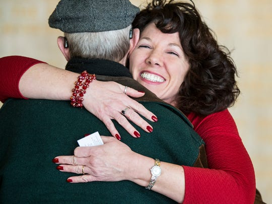 Lebanon Mayor Sherry Capello hugs a supporter after she announced her re-election campaign on Tuesday, Jan. 31, 2016.