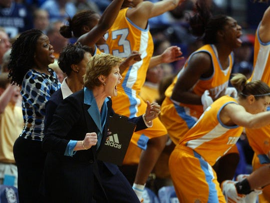 Tennessee coach Pat Summitt, left, reacts with her team as they pull ahead in the final minutes against Connecticut to win, 68-67, in Hartford, Conn., on Jan. 8, 2005.