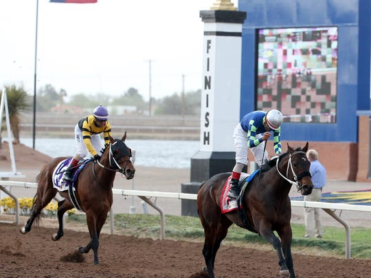 Runaway Ghost and jockey Tracy J. Hebert cross the finish line first in the 15th running of the Sunland Derby Sunday.