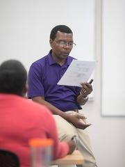 Prof. Douglas Magomo teaches a statistics class at