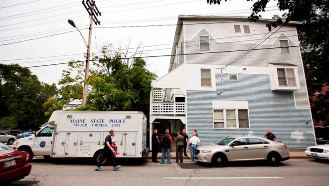 State Police investigate an apartment complex where five members of a family, including three children, were found dead Sunday, July 27, 2014, in Saco, Maine. The bodies of a father, mother and children were found inside the apartment, state police spokesman Steve McCausland said.